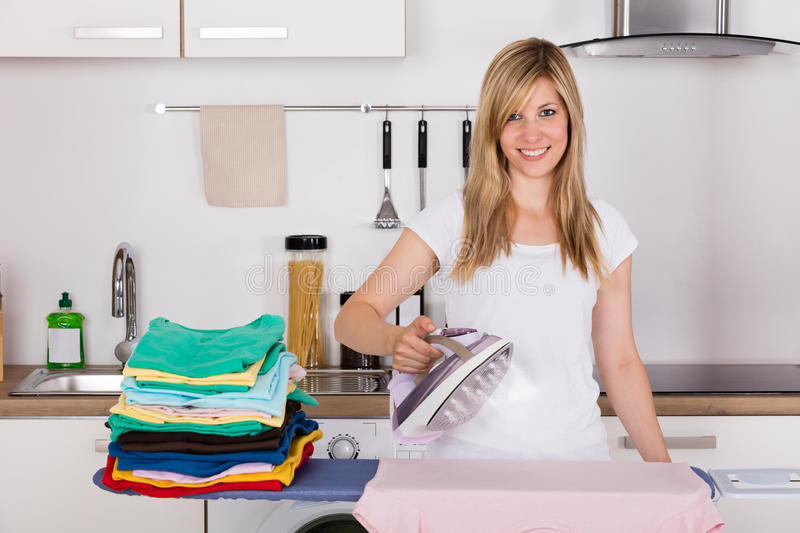 Woman Ironing Clothes With Electric Iron royalty free stock photo