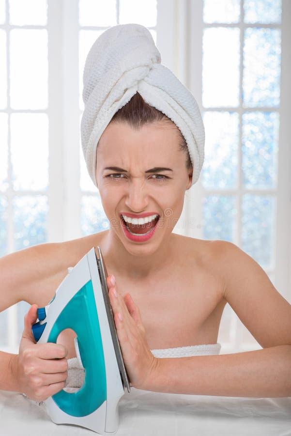 Woman ironing clothes stock photos