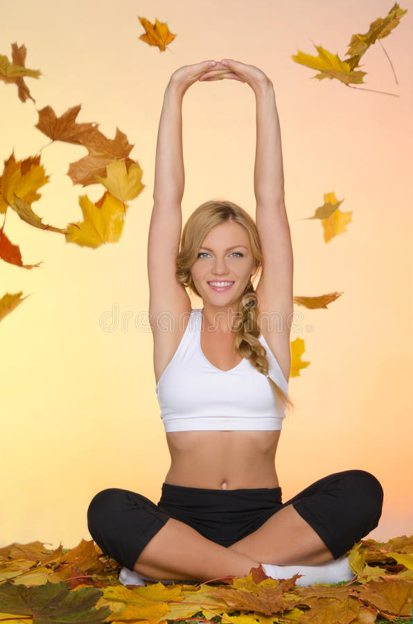 Free Woman Is Engaged In Fitness Under Leaf Royalty Free Stock Photos - 46305728