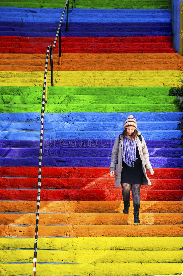 Free Woman Is Walking In The Rainbow-colored Stairs Stock Images - 80557314