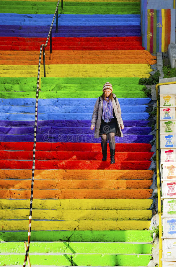 Free Woman Is Walking In The Rainbow-colored Stairs Stock Image - 81436901