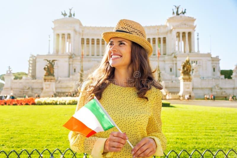 Woman with italian flag on piazza venezia in rome stock photo