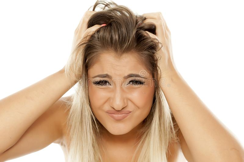 Woman with itchy hair royalty free stock images