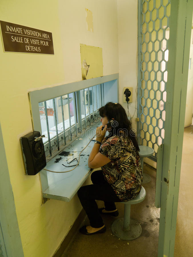 Woman at Jail prison visit area stock images