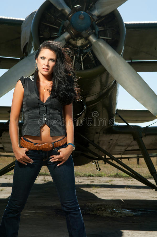 Woman in jeans and aircraft stock photo