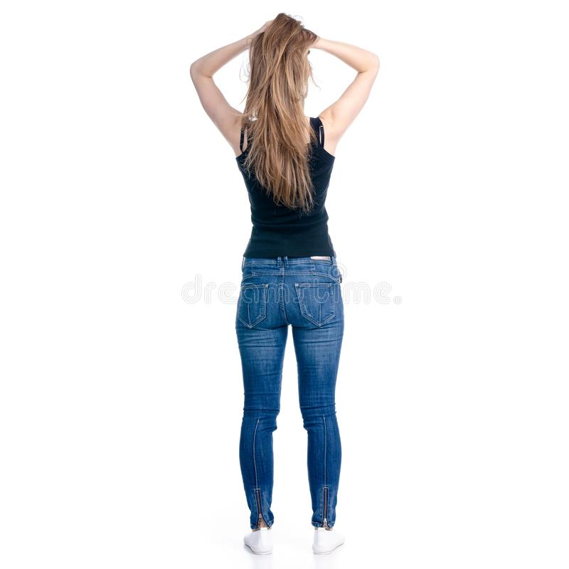 Woman in jeans hand on head royalty free stock photography