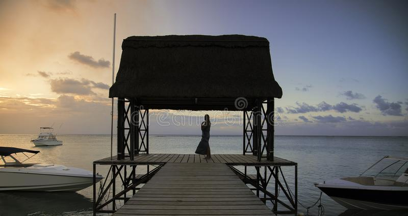 Woman on a jetty stock image