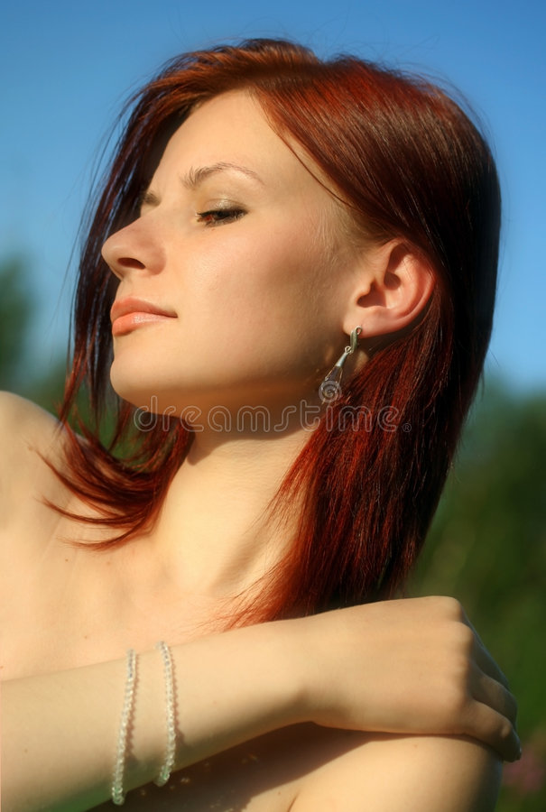 The woman with jeweller ornaments stock photo