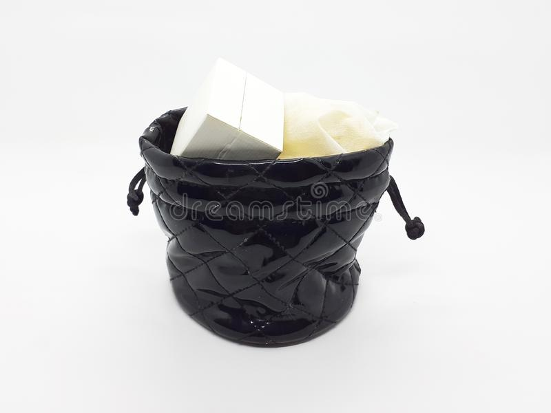 Woman Jewelry Pouch with Contents in White Isolated Background 01. A Black Woman Jewelry Pouch, with Contents in White Isolated Background stock photos