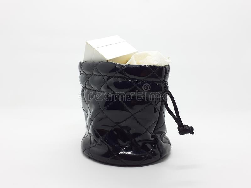 Woman Jewelry Pouch with Contents in White Isolated Background 03. A Black Woman Jewelry Pouch, with Contents in White Isolated Background stock photo