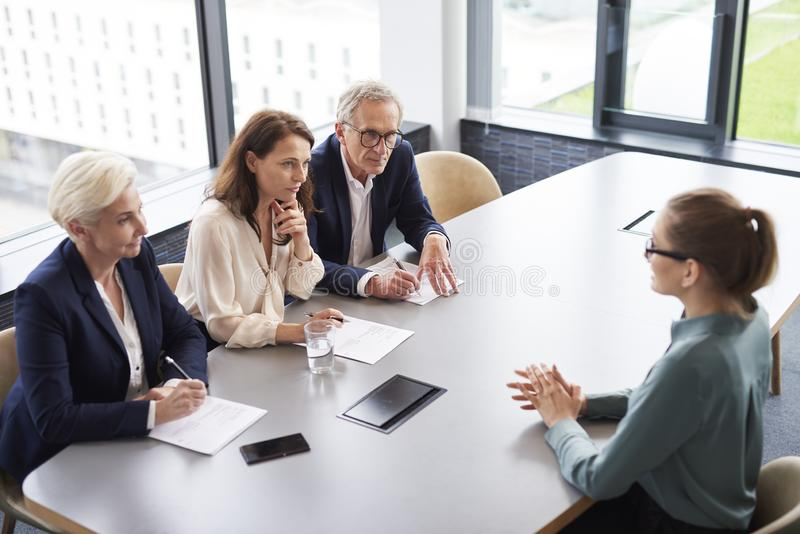 Woman during job interview in the modern office stock images