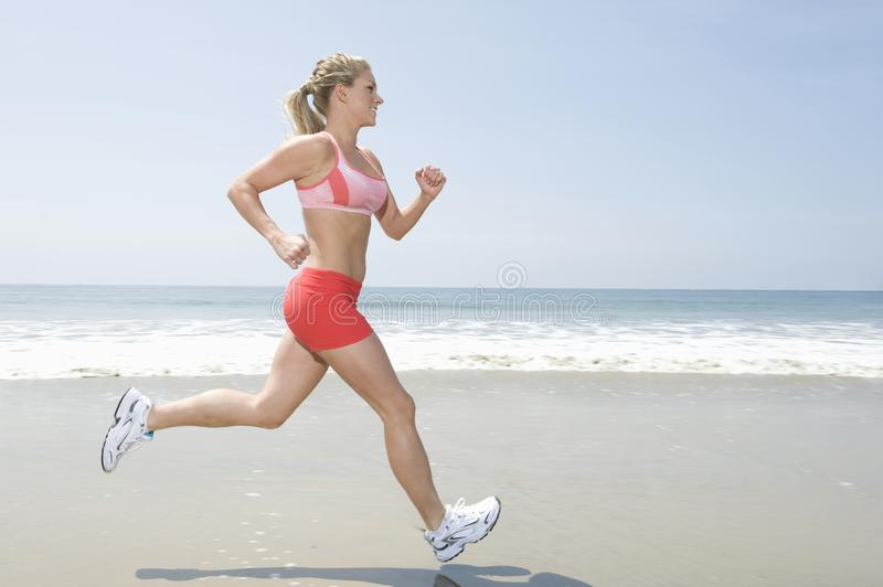Woman Jogging At Beach royalty free stock images