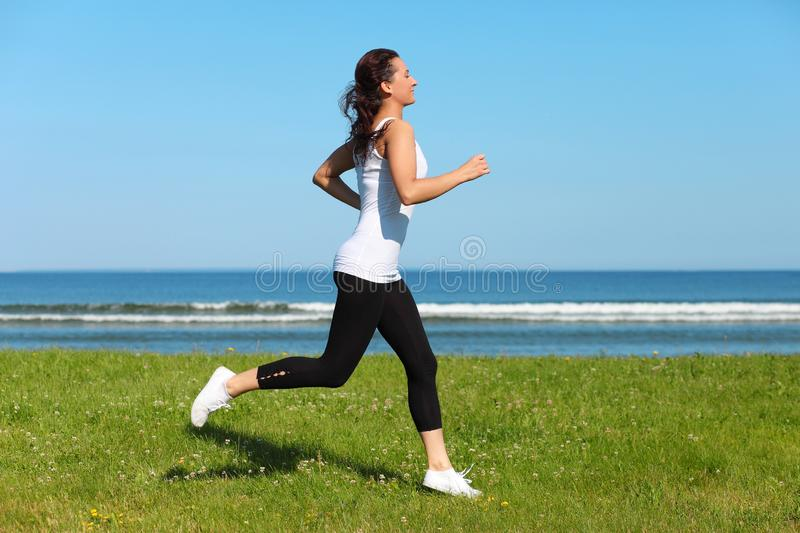 woman jogging on the beach royalty free stock image
