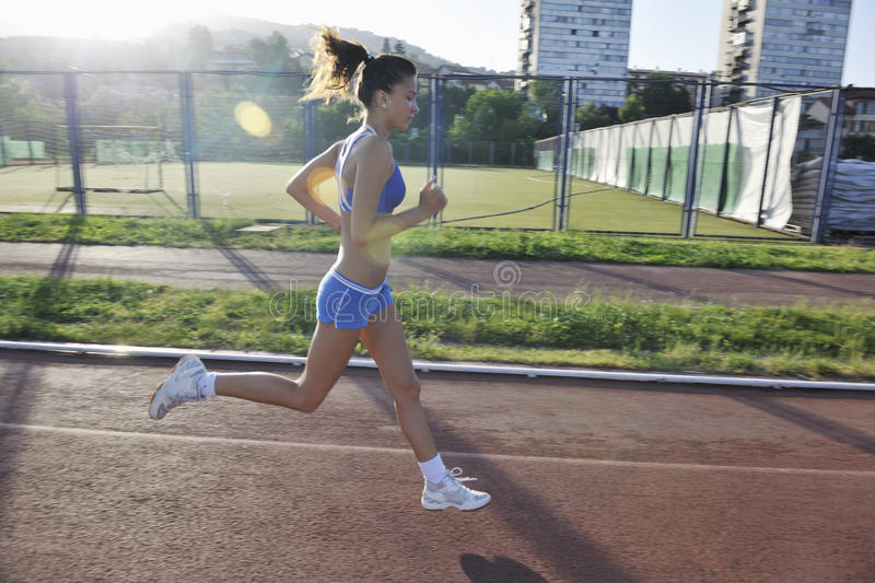 Download Woman Jogging At Early Morning Stock Photo - Image: 14789012