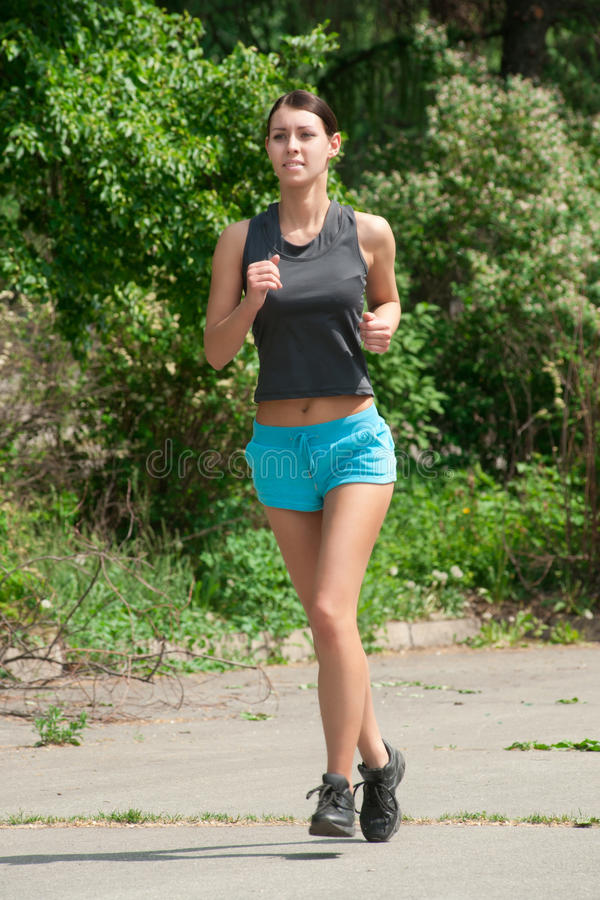 Download Woman jogging in park stock image. Image of active, exercise - 25214691
