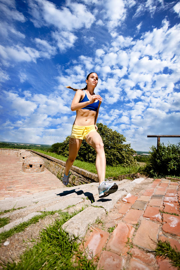 Download Woman Jogging Up Steps stock image. Image of sport, fitness - 27522609