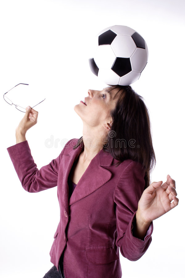 Woman juggling. Woman with soccer ball royalty free stock photo