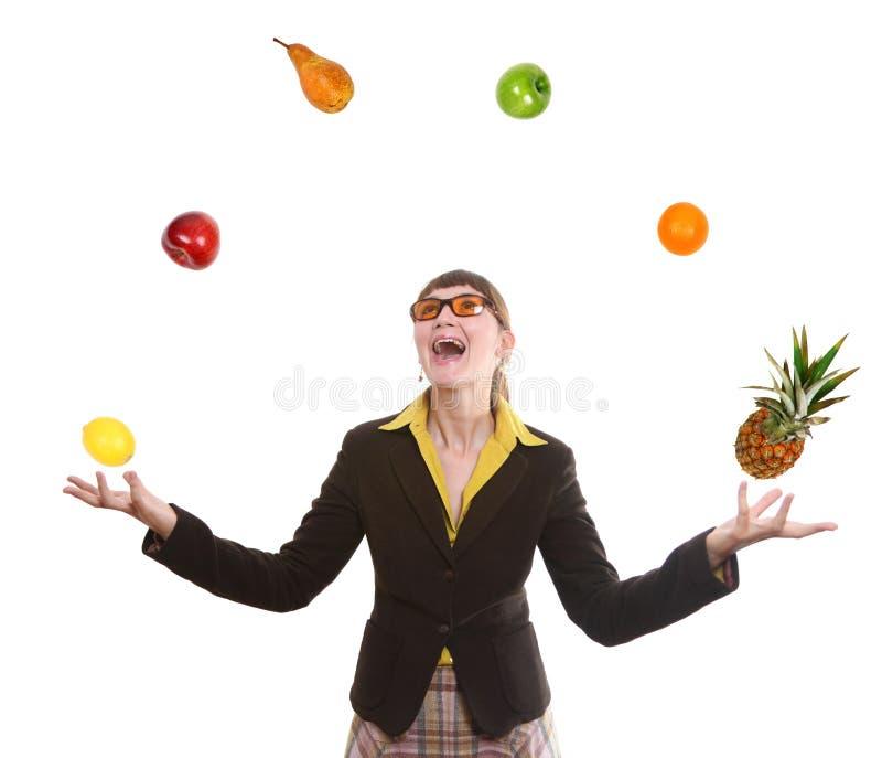Woman juggling fruit stock images