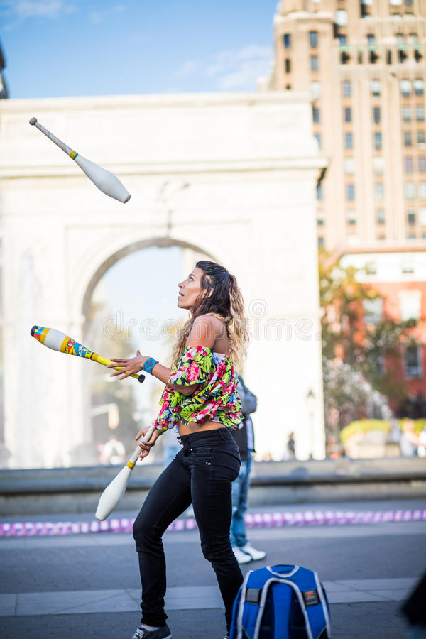 Woman Juggling with Pins, in the Middle of Greenwich Park in New royalty free stock photography