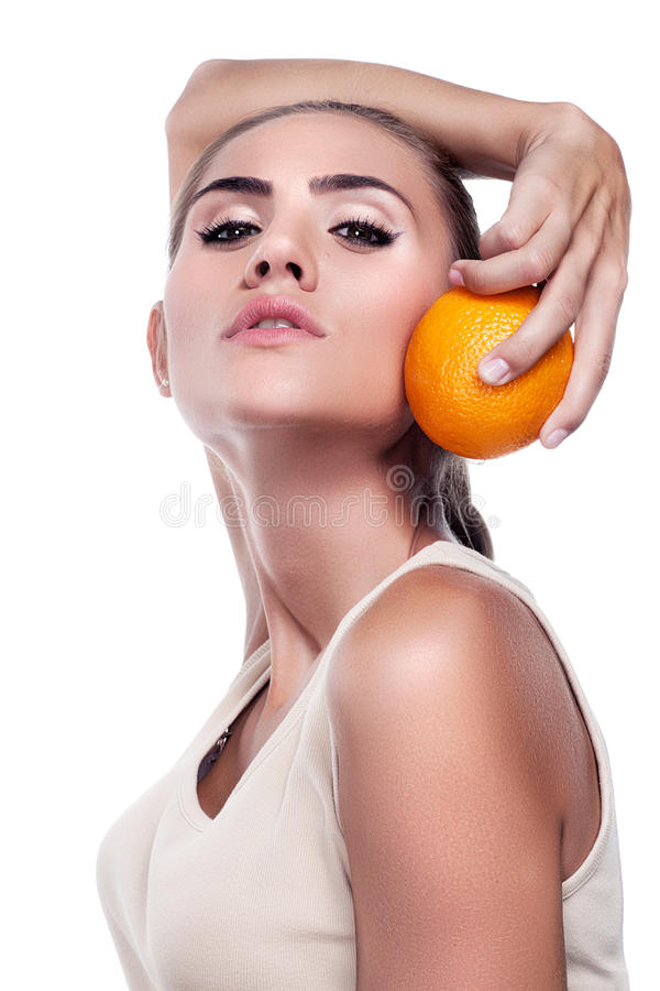 Woman with juice on white background. Concept vegetarian dietin stock photography