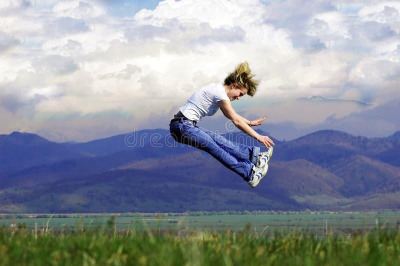 Woman jump royalty free stock photography