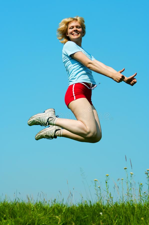 Woman jump outdoor stock images