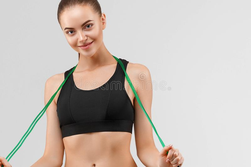 Woman with jump rope studio sport portrait royalty free stock image