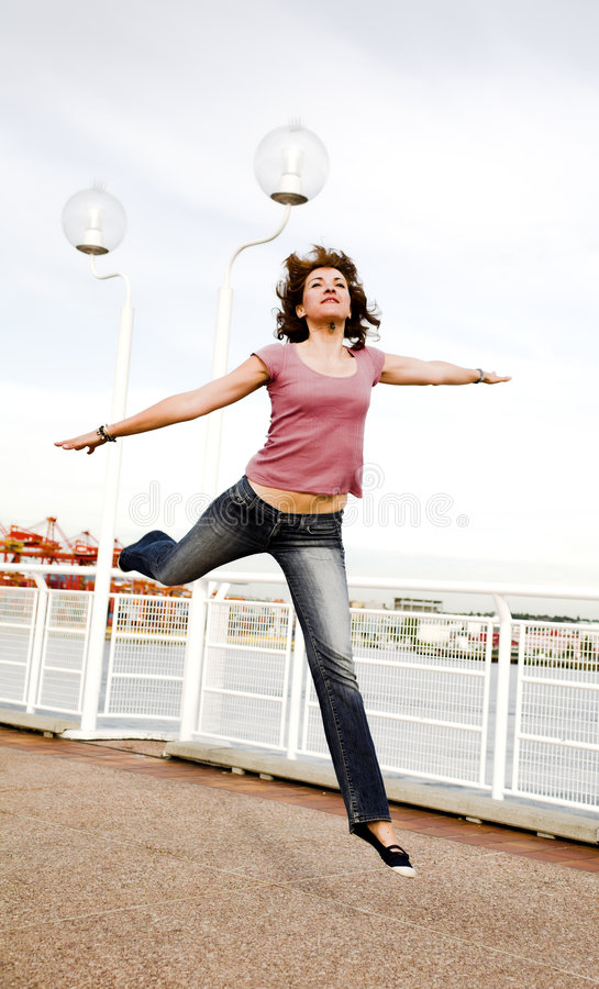 Woman jumping royalty free stock photo