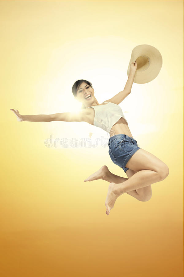 Woman jumping against beautiful sunset royalty free stock photo