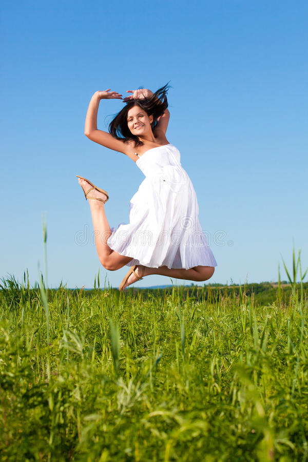 Woman Jumping In The Air Royalty Free Stock Photos