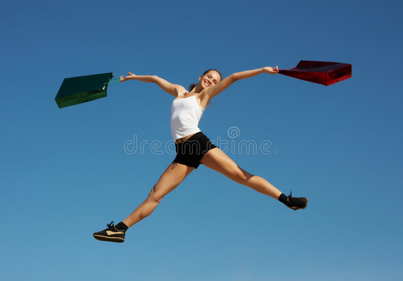 Download Woman jumping with bags stock photo. Image of youth, jump - 6356602