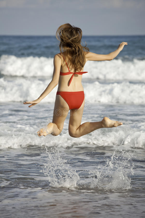 Download Woman jumping on the beach stock image. Image of vacation - 11134663