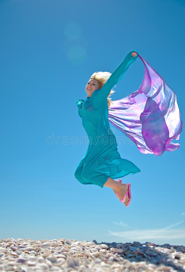 Download Woman jumping on the beach stock photo. Image of adult - 18793798