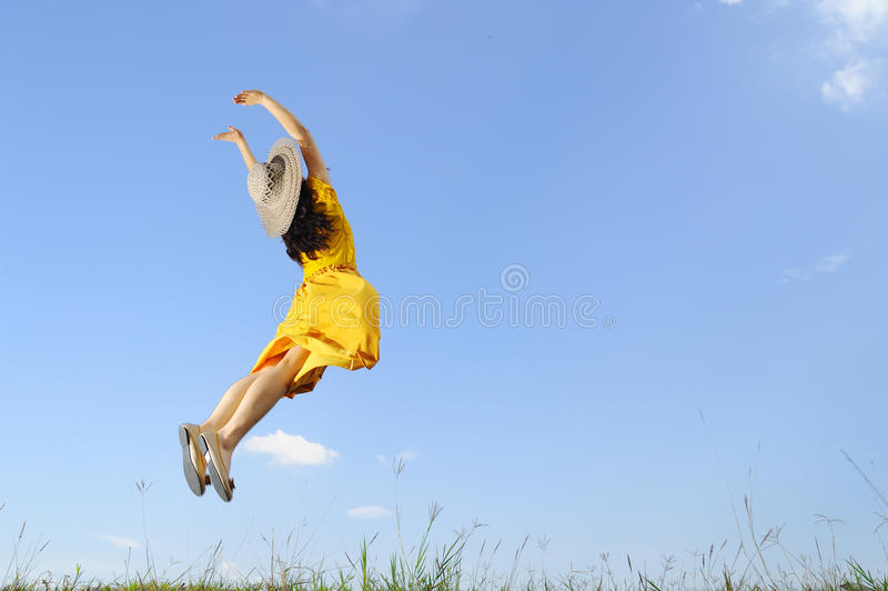 Download Woman Jumping With Blue Sky Stock Photo - Image: 24492398