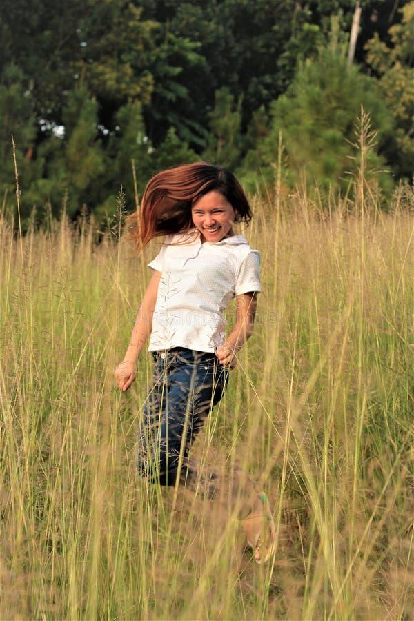 Woman Jumping Between Grass royalty free stock photo