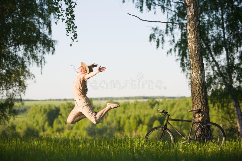 Woman jumping at nature royalty free stock photography