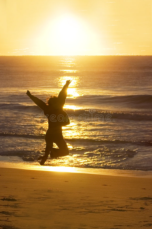 Woman Jumping (A New Beginning) stock images