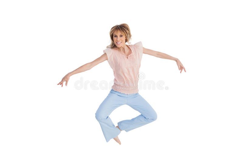 Download Woman Jumping And Opening Arms Stock Photo - Image: 31240176