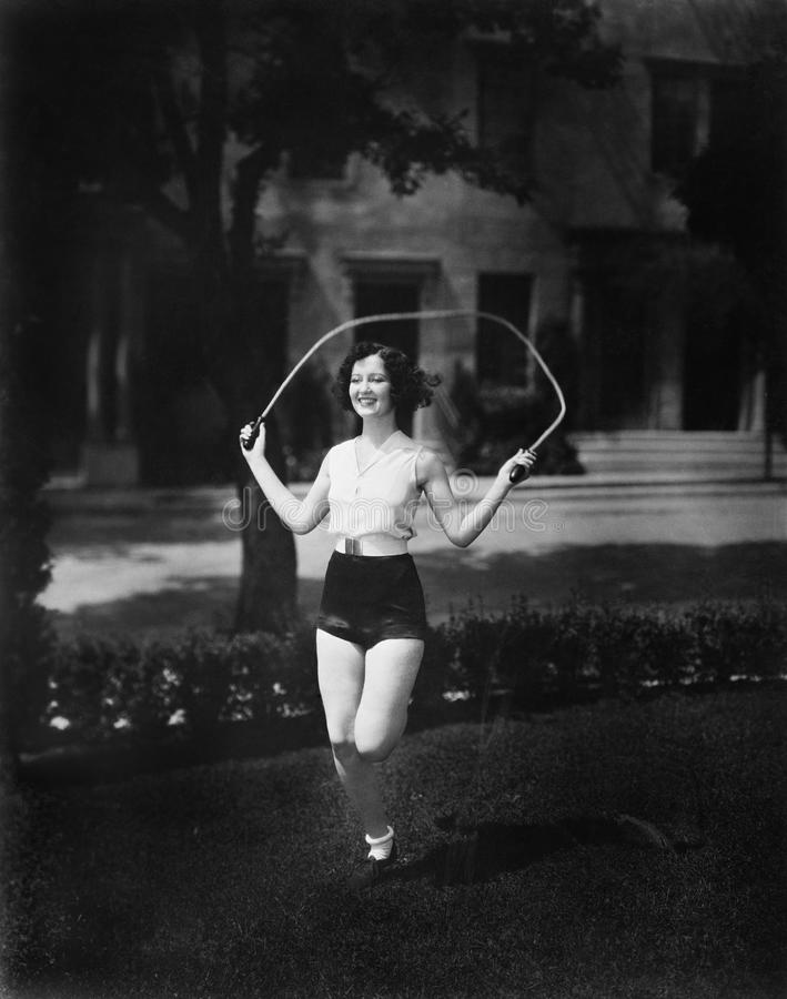 Woman jumping rope. (All persons depicted are no longer living and no estate exists. Supplier grants that there will be no model release issues stock photo