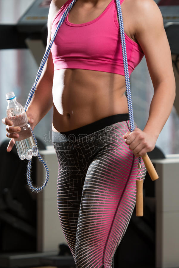 Woman With Jumping Rope And Bottle Of Water stock photography