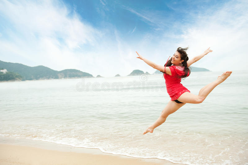 Download Woman jumping in the sea stock image. Image of hands - 12024487
