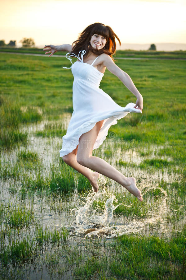 Woman jumping in water royalty free stock photos