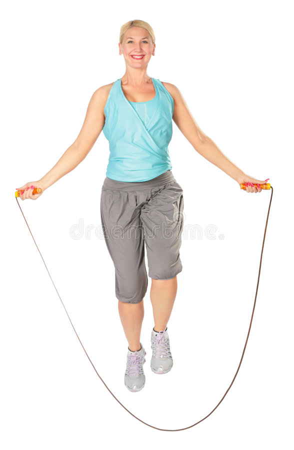 Woman jumps with a skipping rope stock photos