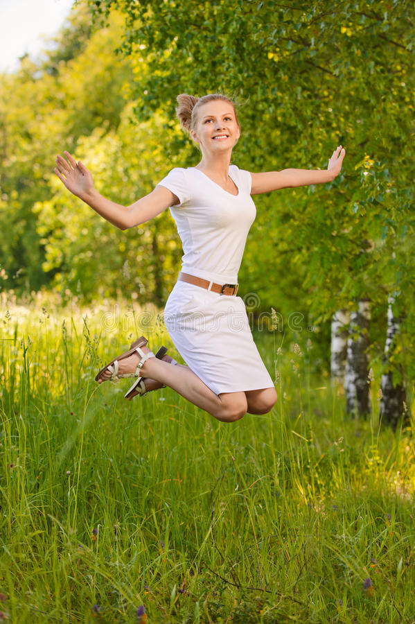 Woman Jumps Upwards And Laughs Royalty Free Stock Photo