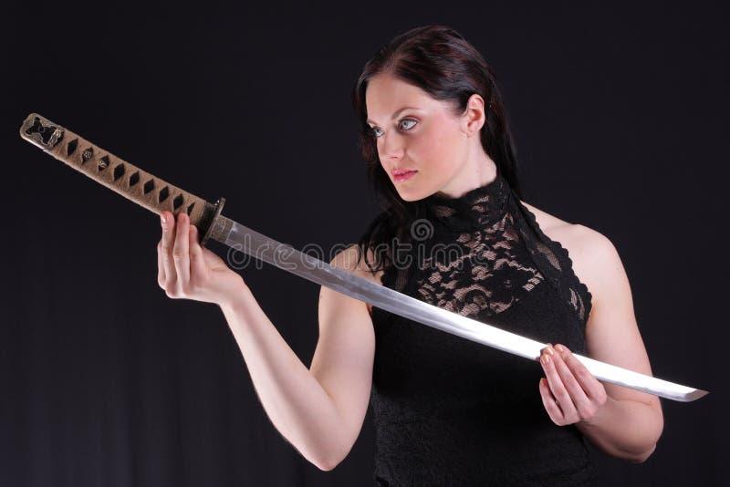 Woman with katana royalty free stock photo