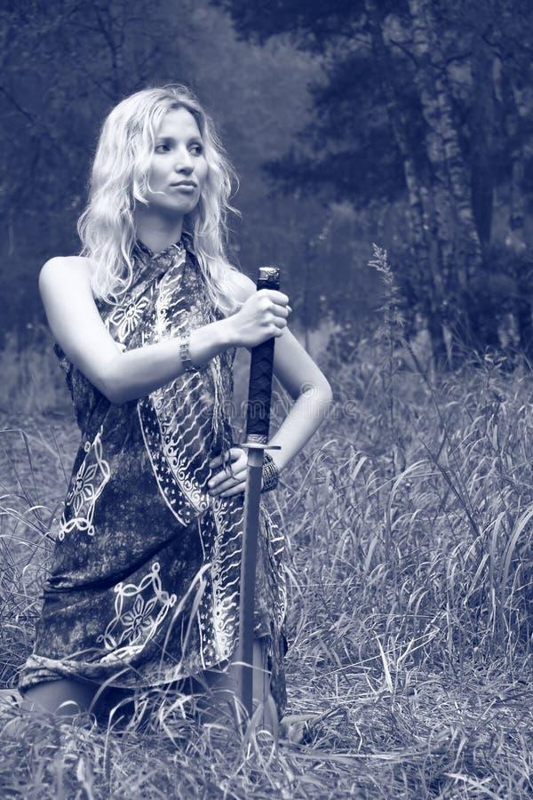 Woman with katana sword stock photo