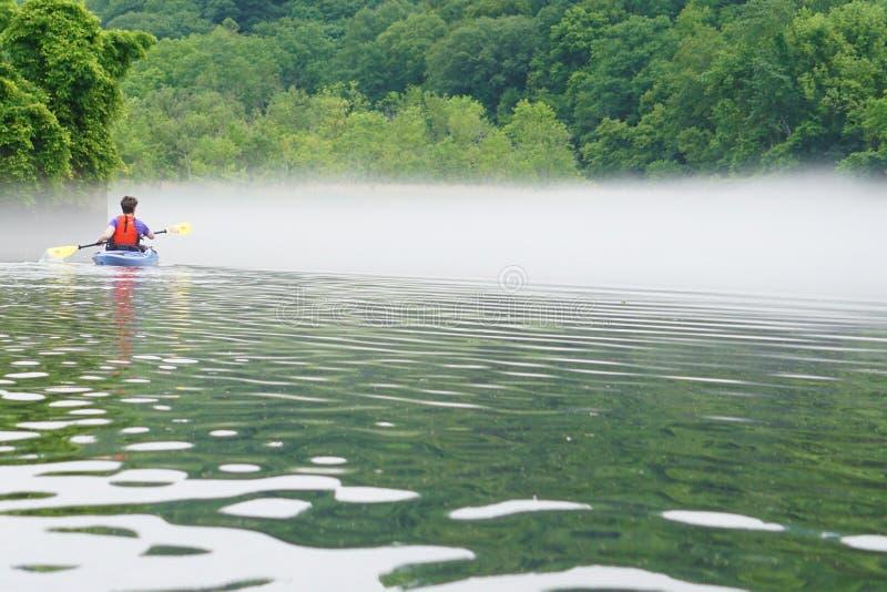 Woman in kayak stock photo