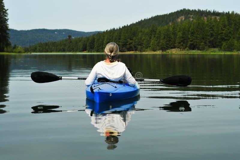 Woman kayaking royalty free stock images