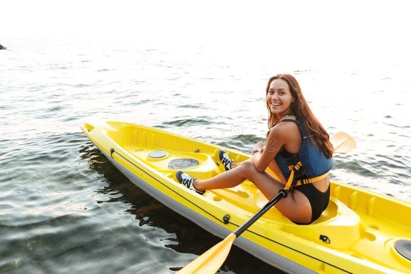 Woman kayaking on lake sea in boat. royalty free stock photos