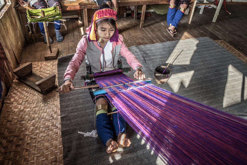Woman of the Kayan Lahwi tribe weaves fabric royalty free stock photography